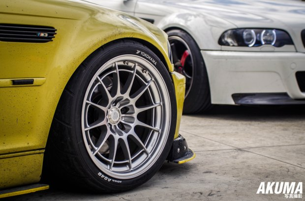 2 E36 M3's waiting to have so fun on the skid pan! Dem NT03 though..